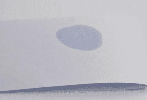 жирное пятно на бумаге