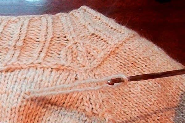 Затяжка на вязаной кофте