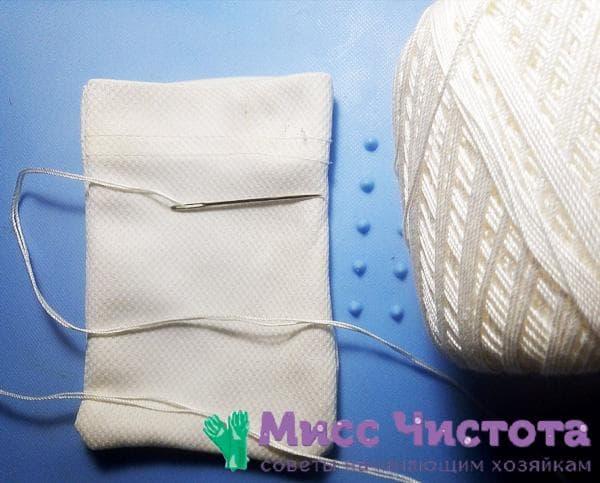 белый мешочек, иголка и нитки